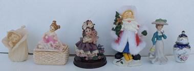 Bonecas decorativas em louça