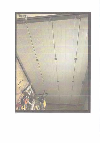 Portão de garagem seccionado com motor eléctrico
